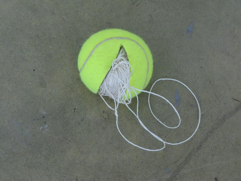 Claire Fontaine, Untitled (tennis ball sculpture) 2008 - palle da tennis riempite con vari oggetti non visibili, dimensioni variaibli